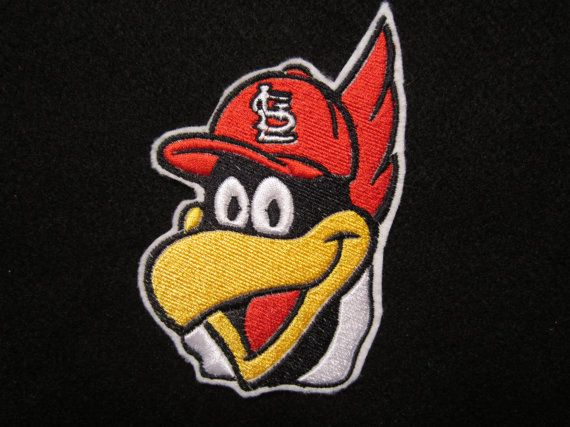 Embroidered St. Louis Cardinals mascot Fred Bird stitched on premium white felt in thread colors of red, yellow, white and black. Show your team spirit by applying this to tee shirts, sweatshirts, hoodies, jackets, vests, bags and backpacks. It measures 5 inches tall by 3 1/2 inches
