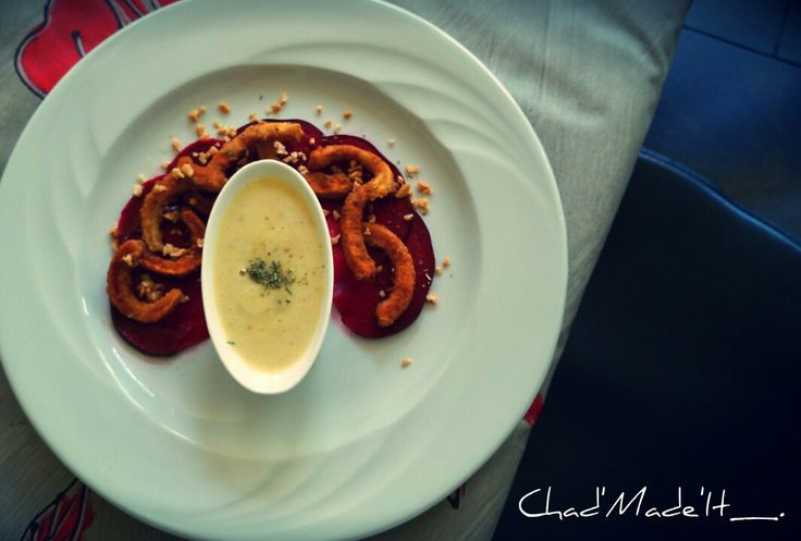 Pan fried calamari served on a fan of pickled beetroot, housemade mayonnaise. Topped with roasted monkey nuts
