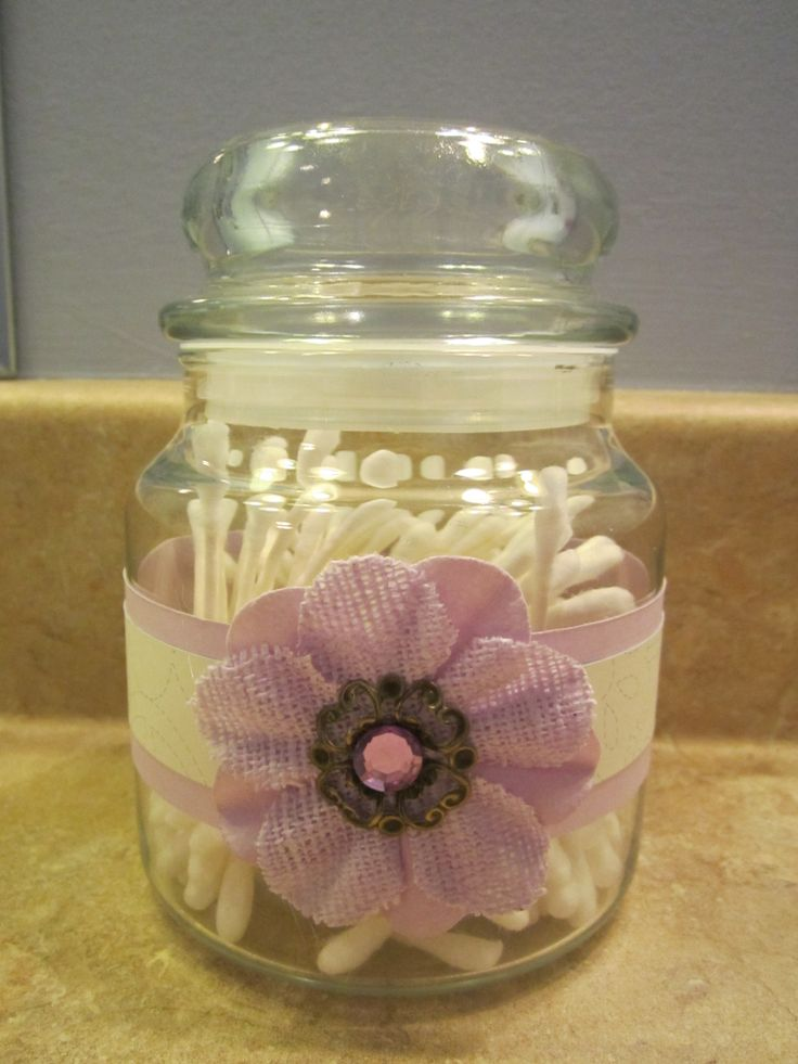 Repurposed Yankee Candle Jar (use boiling water to get the wax out) - I used scrapbook paper around the jar and a fabric flower from Michaels. These jars are just too cute to throw away. Designed and created by Ellie