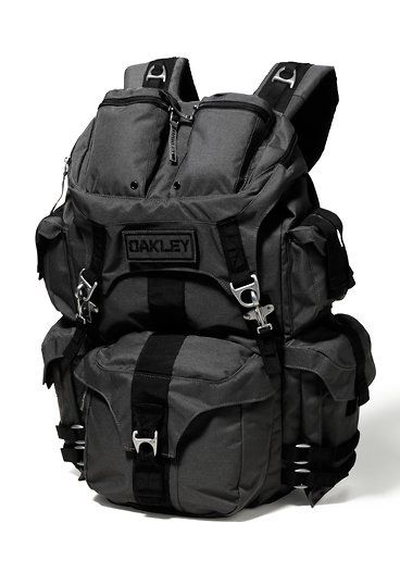"""OAKLEY MECHANISM PACK- Padded internal sleeve holds most 17"""" laptops. Accessories pockets, top flap, and sides with hook and loop closures. Padded adjustable shoulder straps and removable waist strap allow for comfortable carrying. Metal carrying handle and custom clips create secure attachment points. 30L Capacity. 21"""" H x 17"""" W x 9"""" D 100% Polyester. From Oakley.  $160.00"""