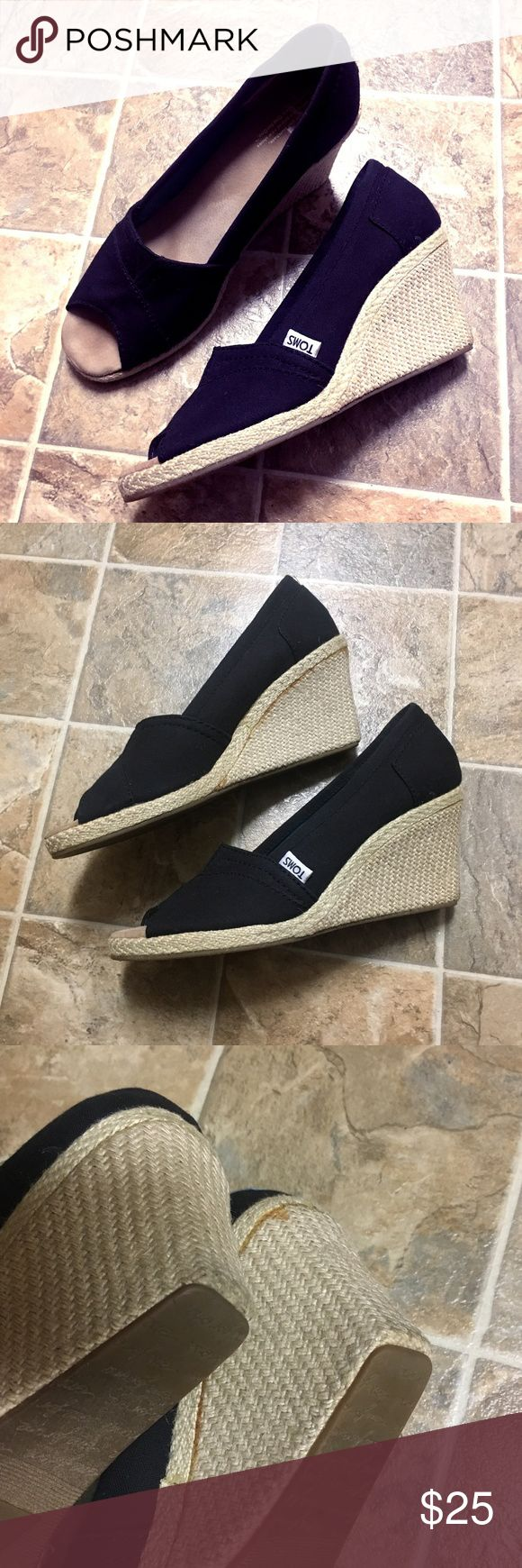 TOMS Black Wedges Espadrilles - Size 9.5 Women's TOMS wedges/espadrilles in a size 9.5. Black cloth upper with light beige woven wedge/sole. In great condition, only worn a handful of times. I did notice that for some reason, it looks like the adhesive is showing through on the right shoe - so where the sole meets the upper part, there's an orange line. This is only on the one shoe. Other than this, there are no flaws or signs of wear - you can see by the bottom of the soles that they have…
