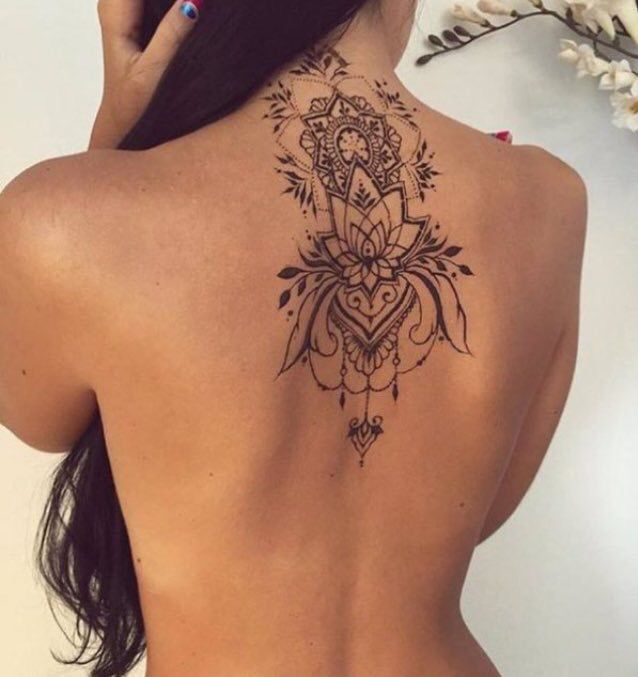 Between-the-shoulder-blades is a beautiful placement for a tattoo with bilateral symmetry.
