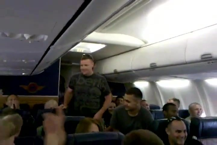 A U.S. Marine sings 'Home' by Michael Buble on a plane  (Video)