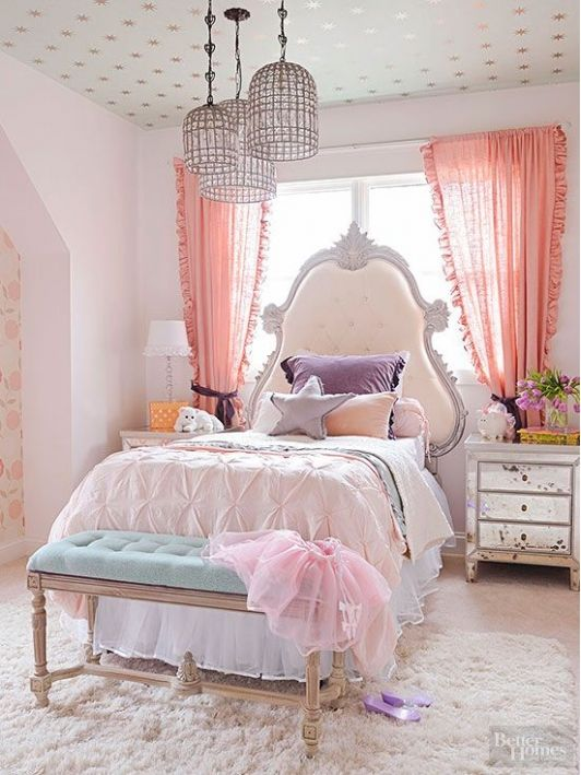 Pastel Girls Bedroom With Elegant Headboard That Complements The Distressed Wood Dressers Beside The Bed