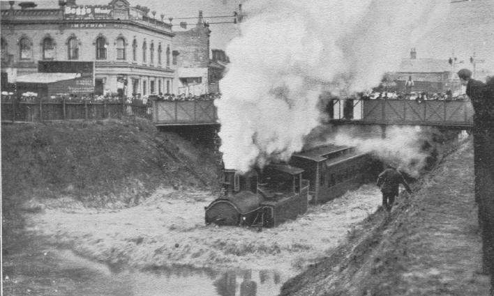 PH 491. The effect of storm. Train passing through flood waters, South Yarra, 25 January 1907.