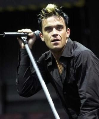 """One of the greatest perfomers on recent times; Robert Peter """"Robbie"""" Williams (born 13 February 1974) is an English singer-songwriter, vocal coach and occasional actor. He is a member of the pop group Take That. Williams rose to fame in the band's first run in the early- to mid-1990s. After many disagreements with the management and certain group members, Williams left the group in 1995 to launch his solo career. On 15 July 2010, it was announced he had rejoined Take That and that the group…"""