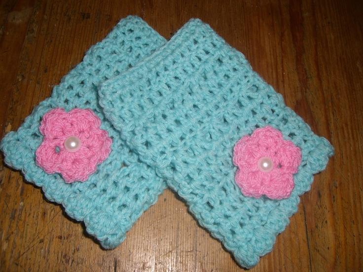 Fingerless mitts in mint green finished with cute pink flower with pearl button centre