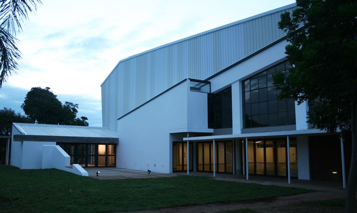 Afrikaans Hoer Meisieskool Pretoria – School Hall in Pretoria, South Africa. With these additions, funded by Miss Steijn, then principal's inheritance, the architects wanted to designing true to the contemporary architectural spirit while respecting the old. An NID was submitted to the heritage agencies due to the architects' passion of preserving the modernist legacy and the memory of this iconic institution. By Mathews and Associates Architects, completed in 2012. Photo by MAAA
