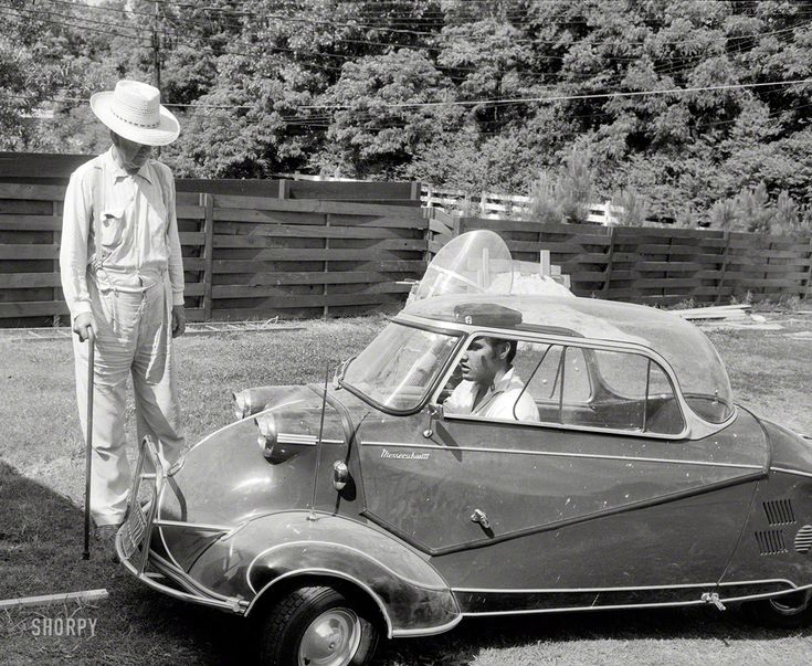 "Elvis Presley in 1956 at home in Memphis with his three-wheeled Messerschmitt ""bubble car"""
