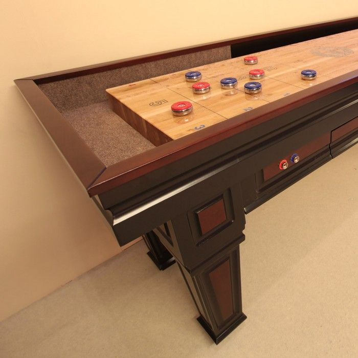 The Texan-made Worthington Shuffleboard possesses its own distinctive style, infused with hints of an Italian Gothic design. Its maple wood cabinet comes in a variety of finishes, from aged matte black to deep cherry.