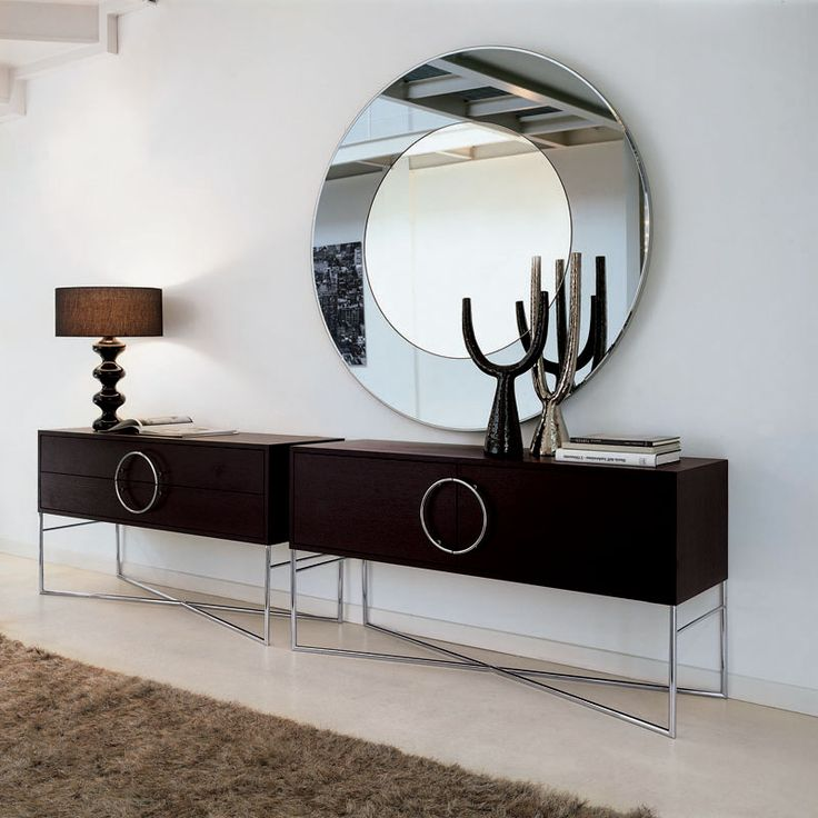 Orbit designed by Azzarello is an exquisite contemporary credenza available with doors or drawers.