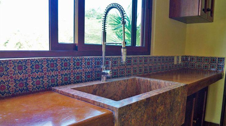 Stone sink and customized kitchen. Hacienda del Rio, RCustom rtirement homes. Playa del Carmen real estate area.