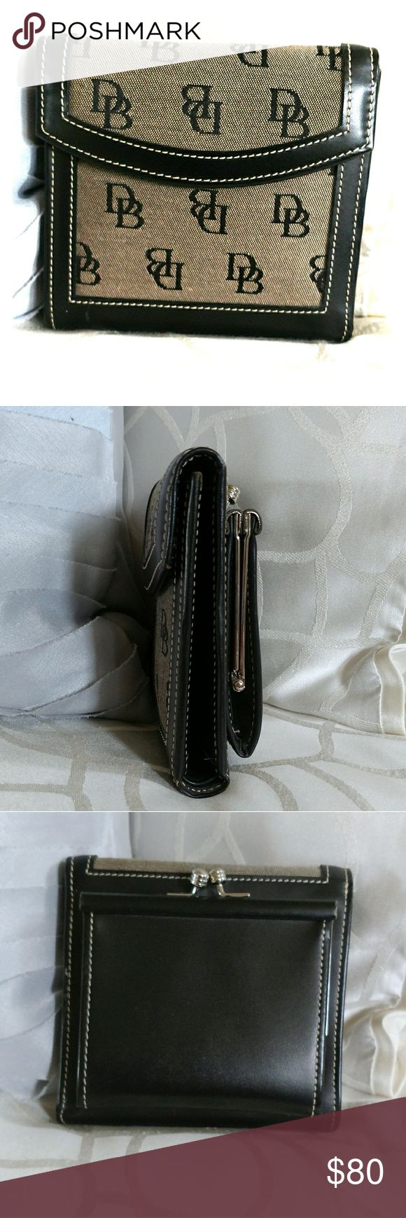 """Vintage DOONEY and BOURKE Black wallet NWOT Dooney & Bourke wallet.  Black and grey.  Please note: refer to first photo. Bottom left. Very faint mark.  Probably 1/8"""" and very light but I want to point it out. Please refer to photo with inside coin area. I'm not sure what happened there.    This item is new and has not been used.  Comes from a smoke-free home. Please ask all questions prior to purchasing. Dooney & Bourke Bags Wallets"""