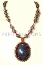 Fantastic Peruzi focal surrounded by 11' & 15's on a matching etched glass necklace
