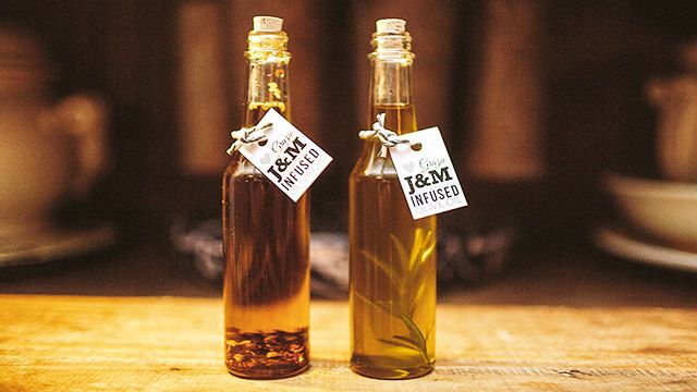 This couple handmade infused olive oils with rosemary and chilli to give to their guests as bomboniere. Image: Simon Peter Taylor