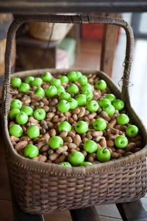 A basket full of peanuts and miniature green apples to greet you at the door. Donovans Restaurant