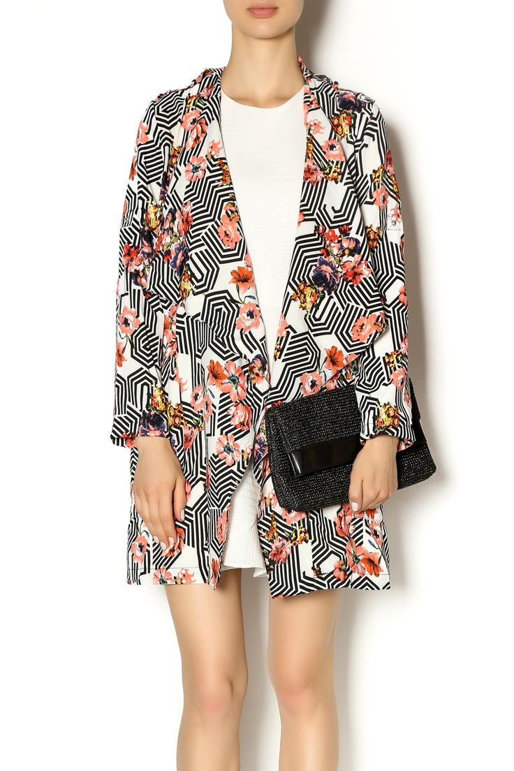 Vibrant printed open kimono features a waterfall neck line and overlying panel across the back in the same print. has side pockets. It is a very versatile piece and looks beautiful over a simple white dress or paired with black shorts and black strappy heels.