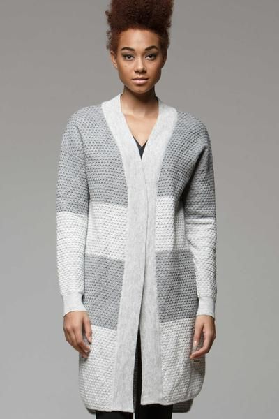 Why not cocoon yourself up in this warm and cozy waffle textured cardigan? Ideal for layering, the neutral color and rounded hem make this piece an easy choice to wear with leggings to work, or to throw on post-work out.