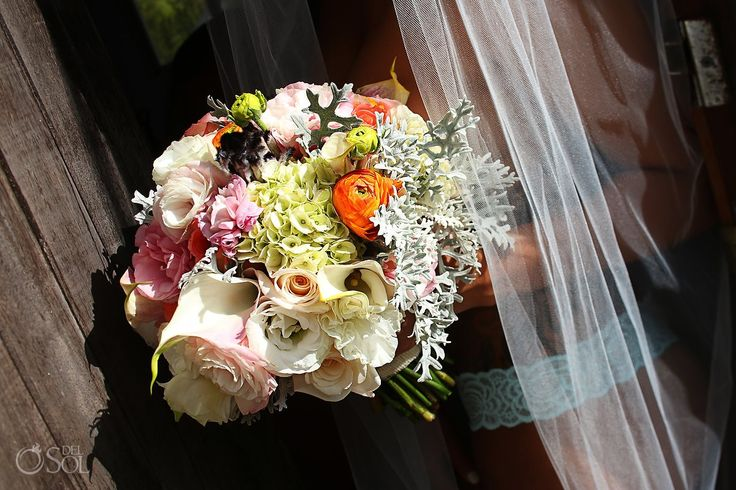 Gorgeous bridal bouquet for a beach wedding at the Akiin Beach Club in Tulum. Mexico wedding photographers Del Sol Photography.