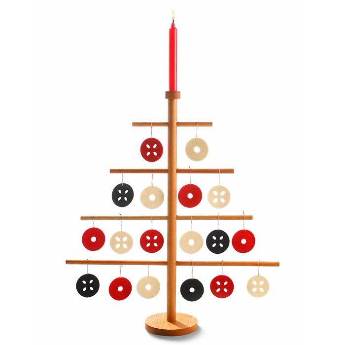 Wood Christmas Tree + Felt Ornaments Can make for sending to missionary for Christmas. Have kids trace cookie cutter shapes on felt, cut out and decorate. Drill holes in large dowel to insert long thin ones through for branches.