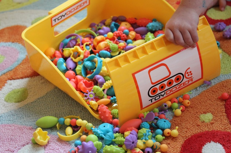 Kids can scoop up their legos and other  little toy pieces in this adorable Toy Dozer! Comes in other colors too!! Storage ideas- by personal organizer/lifestyle expert Staci Krell 212.714.8005 NY-NJ-CT