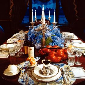 Shabbat table with gorgeous blue flower arrangement and ...