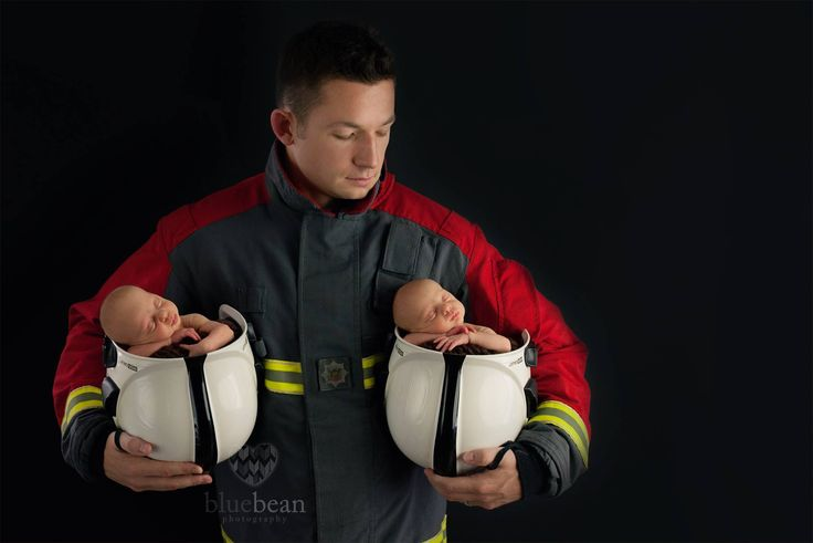 Twins with firefighter daddy. Twins with fireman daddy. firefighter newborn baby photography. Fireman helmet. Firefighter helmet