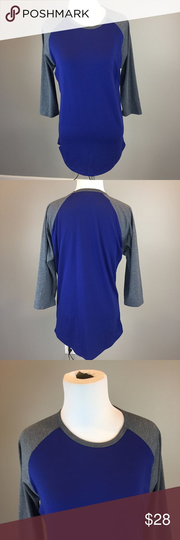 """LULAROE Gray Blue Randy Baseball 3/4 Sl Tee SZ S Measurements.  Armpit to armpit laying flat 21"""" Length from top of shoulder to bottom of shirt 31"""" Good pre owned condition. Comes from a smoke free home LuLaRoe Tops Tunics"""