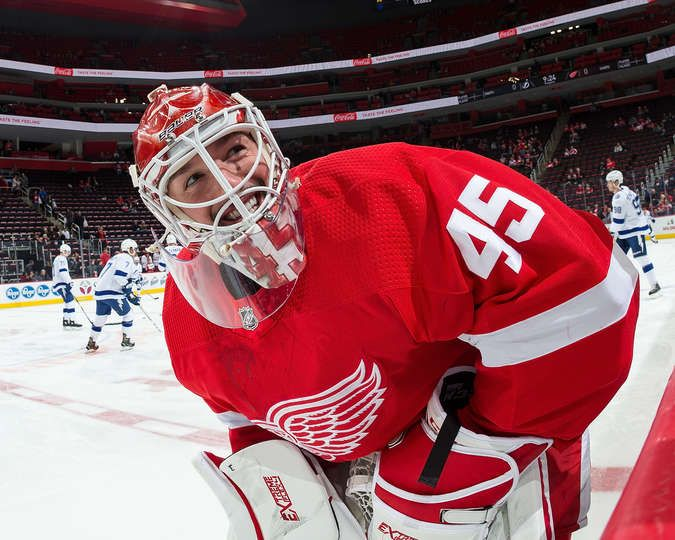 Detroit Mi December 04 Jonathan Bernier 45 Of The Detroit Red Wings Smiles At His Son In The Stands During Wa Detroit Red Wings Red Wings Football Helmets