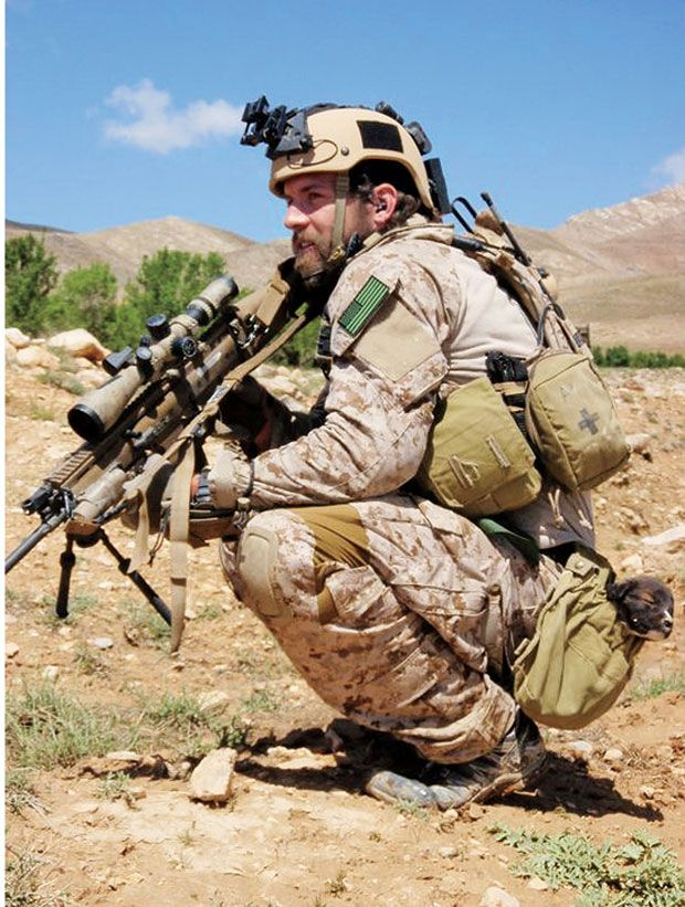 US Navy SEAL Brendan Looney pictured here with an interesting load in his utility pouch. He was KIA on 9/21/10, RIP