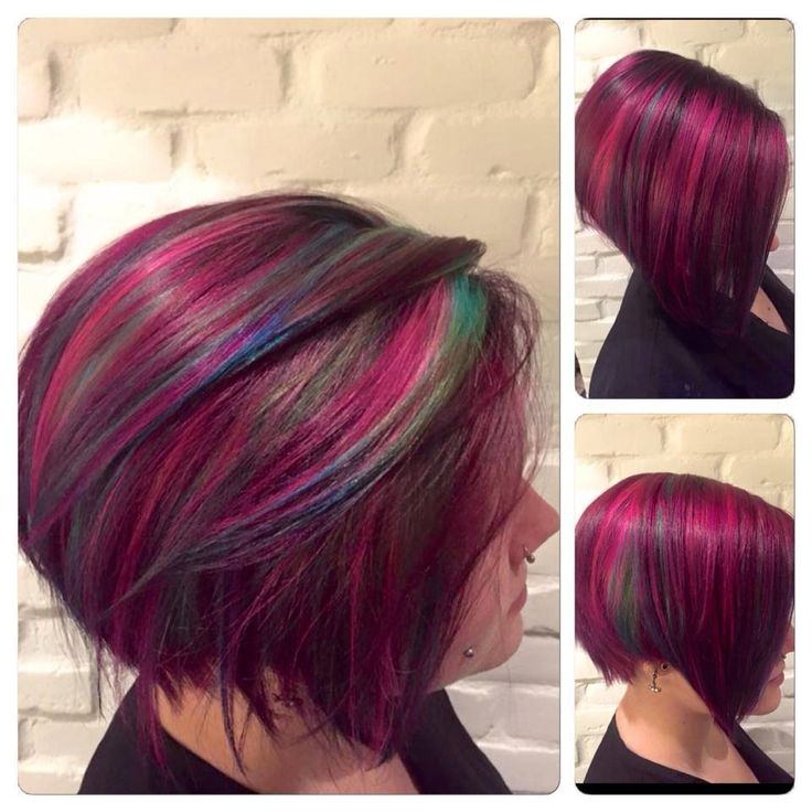 Pink hair with a touch of blue and green created by Vanessa Champagne