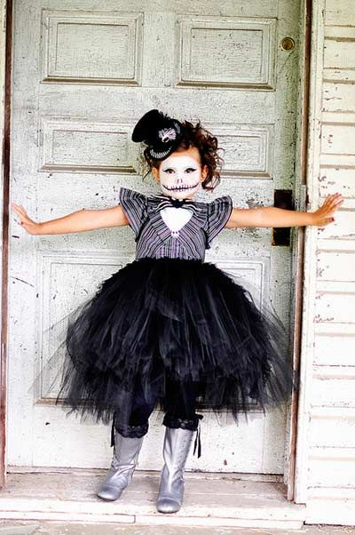 Jack skellington tutu halloween costume for girls. Your little girl will look super spooky in this dress up inspired by the nightmare before christmas. The outfit is made up of a black top hat, pinstripe shirt, black tutu and stockings and topped off with silver gumboots.