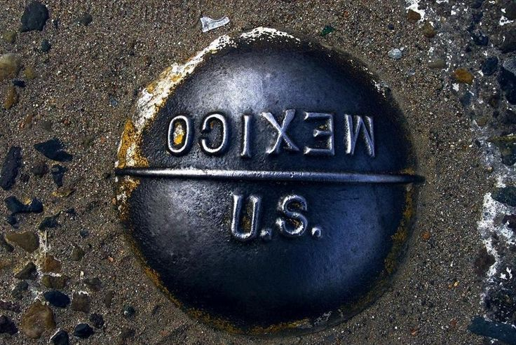 A marker embedded in the pavement marks the imaginary line between the United States and Mexico at the San Ysidro border crossing between San Diego, Calif., and Tijuana, Mexico.