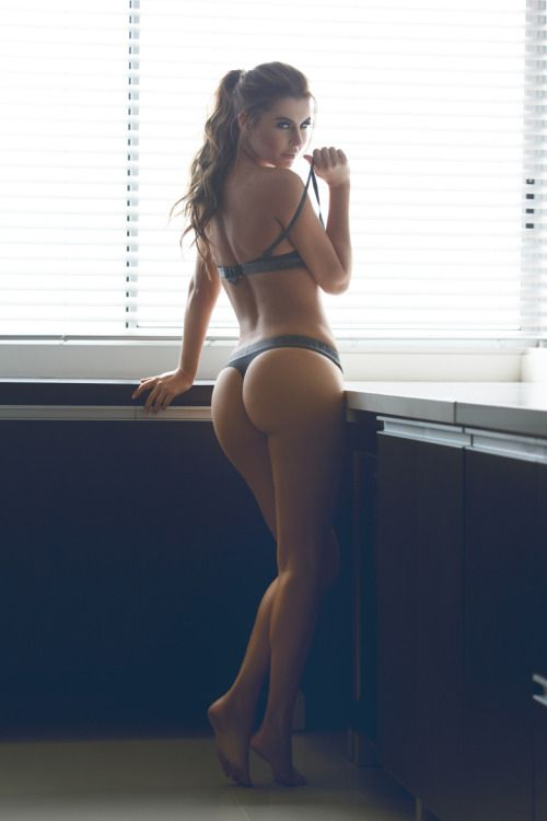 Brunette milf in thong posing