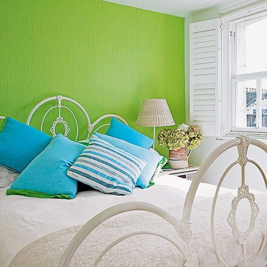 Modern bedroom with green feature wall