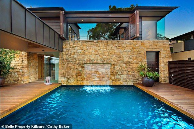 This Sandstone Home In A Suburban Street Hides A Luxury Property Swimming Pools Luxury Property Backyard Pool