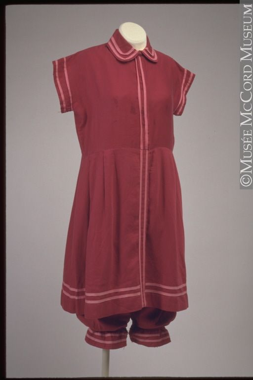 """Two-Piece Bathing Suit: 1910-1920. """"Towards the end of the 19th century, swimming was becoming a more and more popular pastime in Quebec... During this time, women's bathing suits were like long dresses and were difficult to swim in since they were often worn over a corset until the 1890s. A practical, comfortable women's bathing suit, which only became available at the beginning of the 20th century, would be adopted by woman who... really wanted to swim."""