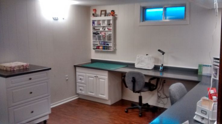 Embellishment area with cupboard storage underneath for stamping supplies and scrapbooking albums, sewing supplies.  Sewing machine and craft light to the right.