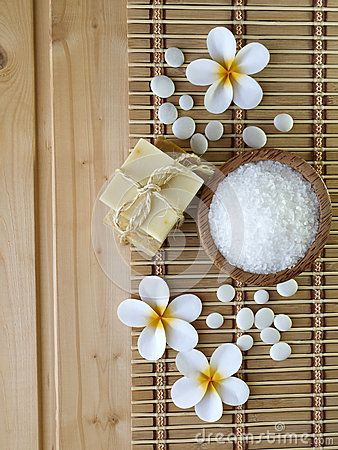 Soap, stones and tiare flowers on the wooden background