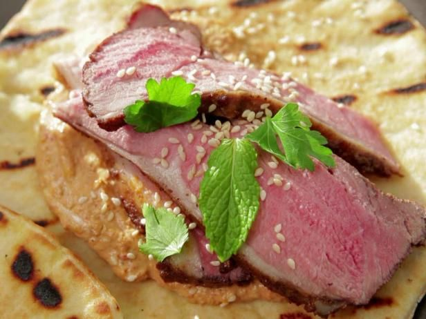 Get Ras El Hanout Marinated Lamb Shawarma with Red Pepper-Walnut Tahini Sauce Recipe from Food Network