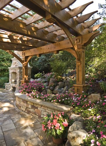Pergola, curved stone wall, impatiens, fireplace, stone terrace... it's all beautiful!