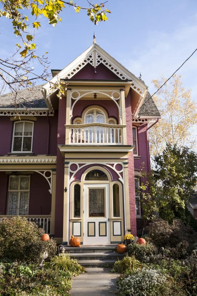 How to Pick the Right Color for Your House's Exterior: Rose-colored Victorian home with white and cream details
