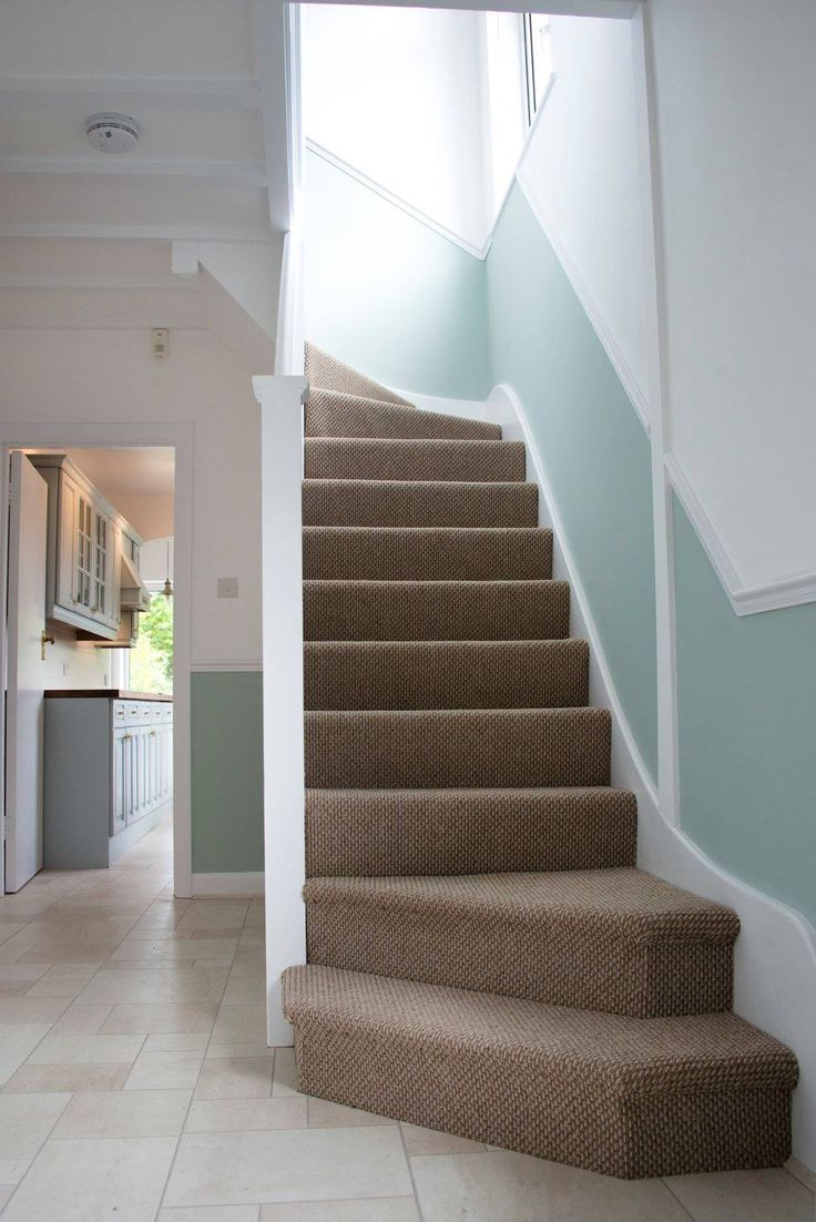 Hallway flooring by Quickstep Exquisa 1553. Dado rail. Carpeted stairs.