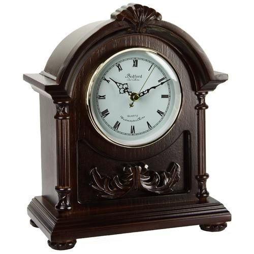 Bedford Clock Collection Wood Mantel Clock with Chimes. This exquisite Mantel clock features a dark finish. Rich and deeply colored it is timeless and exquisite. The dial is bright and perfectly brings forward the roman numerals for your ease. This classic Mantel clock is a stunning addition to any room, whether it is above a fireplace or on a desk. Has 4 chime modes and a volume control toggle.Proudly Made with maintenance free, precision Quartz MovementClockworks chime runs on 3 standard…
