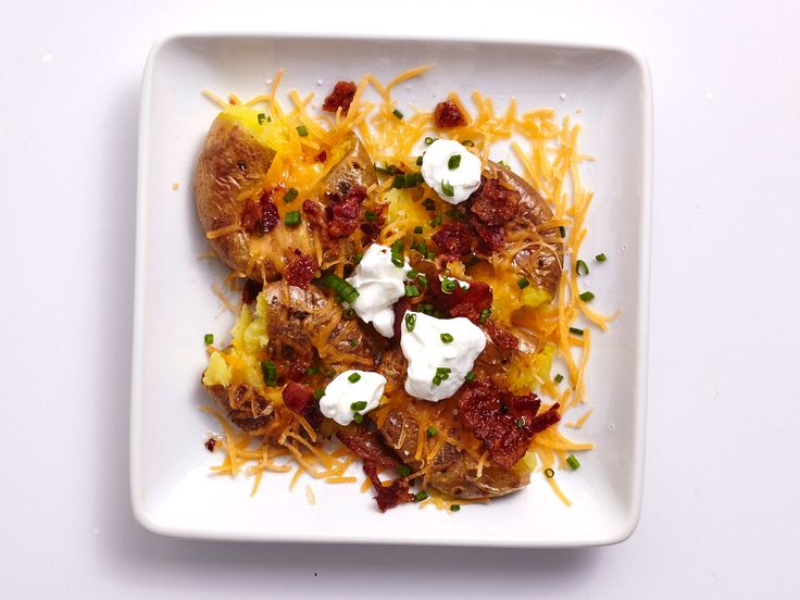 Make Loaded Potatoes in an Air Fryer | Comfort food just got quicker and easier courtesy of your air fryer. These crispy potatoes may seem indulgent, but smart portions of bacon, cheese, and sour cream add big flavor while keeping calories and sat fat in check. The secret is the center-cut bacon—it cooks up nice and crispy, and yields just enough pan drippings to make these potatoes really shine. Serve these tender-crispy spuds with a skillet-seared steak and a side of your favorite steamed