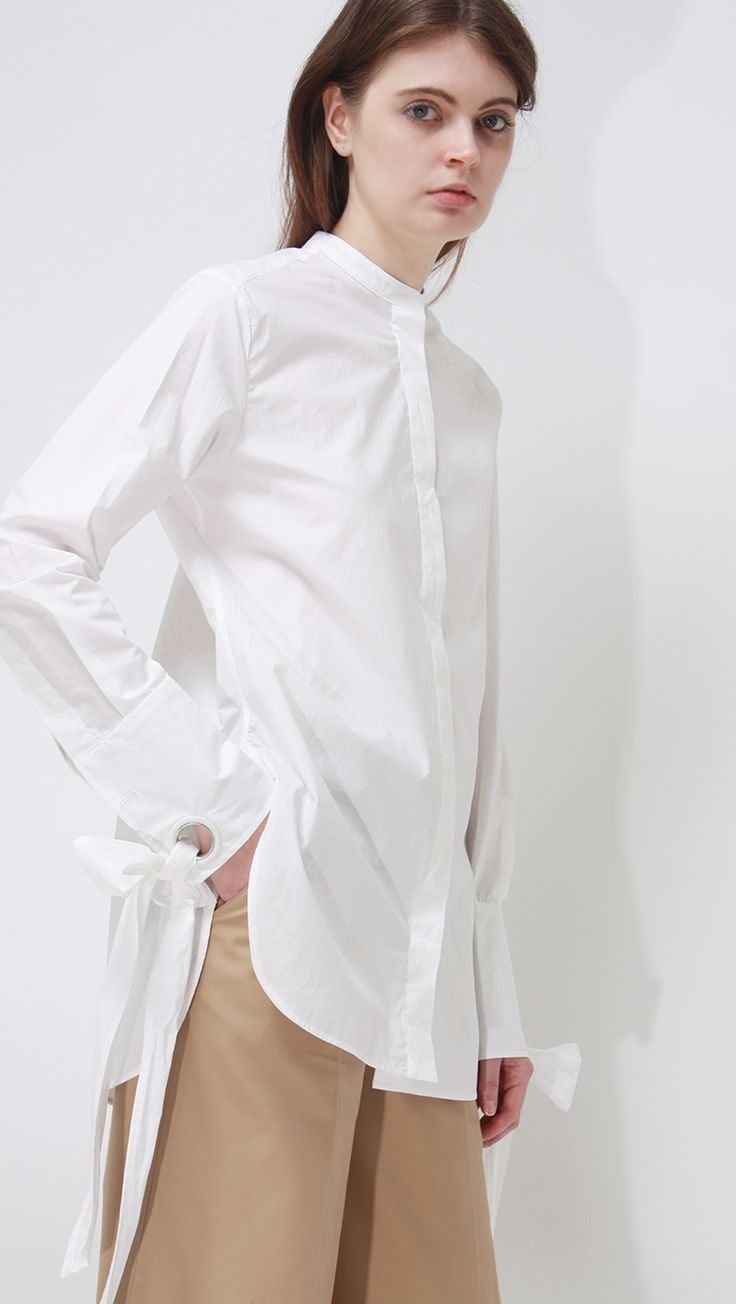 Tackle 3 Trends In 1 With This Insanely Popular Button-Up #refinery29  http://www.refinery29.com/pixie-market-best-sellers#slide-5  Get creative with a white button-up through details, like statement bows at the sleeves.Loéil Edinburch Shirt, $158, available at Loéil....