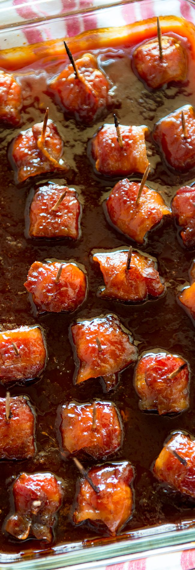 Bacon Wrapped Water Chestnuts - Just tried these for a holiday party. Such an easy and absolutely delicious appetizer recipe! You can't eat just one! These are made with ketchup, brown sugar and soy sauce. YUM.
