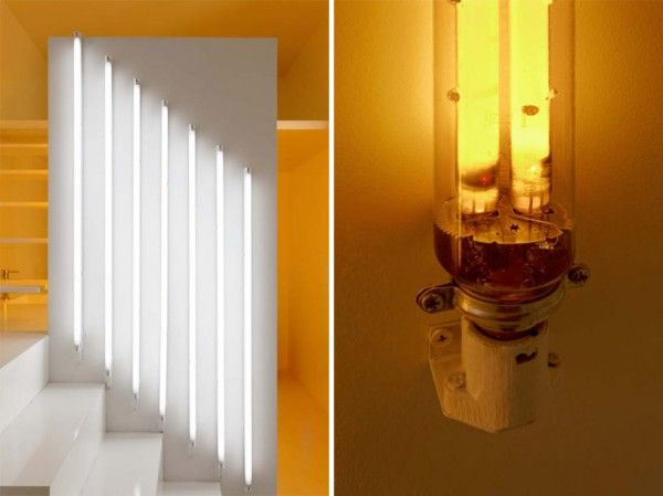 This detail shows two light spectrums, cool and warm, from two different types of bulbs. From kitchen to bathroom at the far end, the lights create a color blocked effect.
