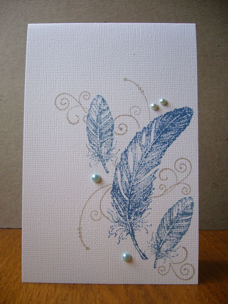 handmade card ... one layer ... flourishes and teathers ... a few pearls ... delightful!