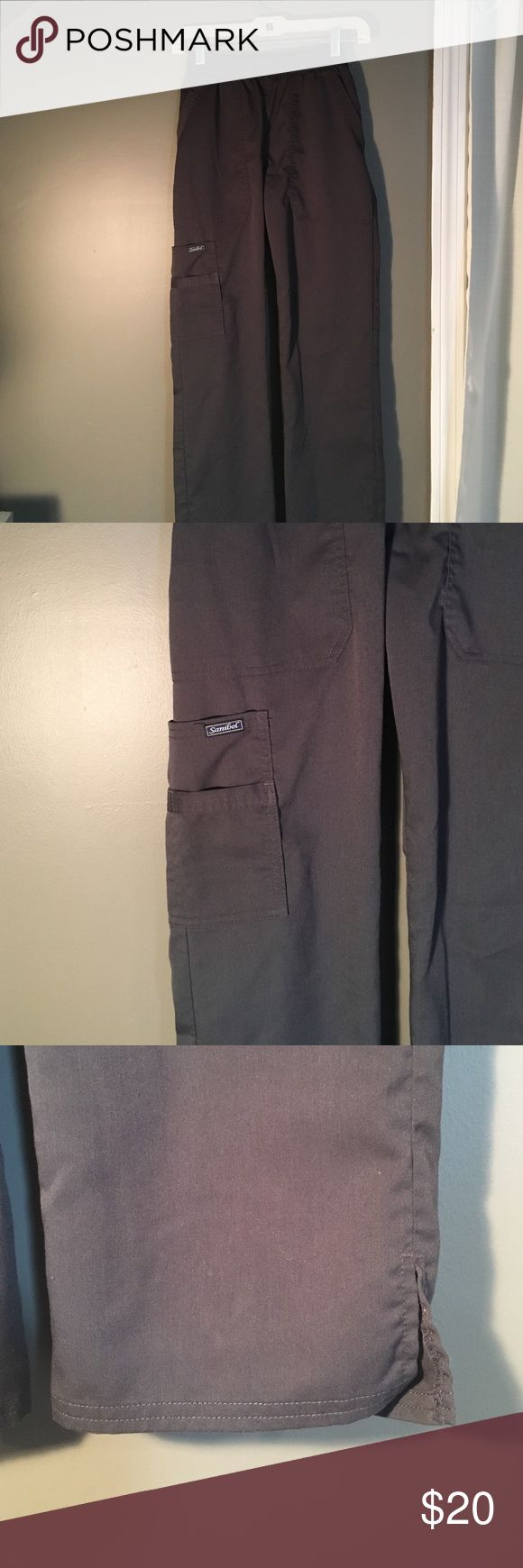 Grey scrub pants 💉SCRUB SALE THURSDAY💉 This picture does not do these pants justice, they are a really nice cut and dark grey color! They are just a little too long for me 😞 I've never worn these (as I wore the green ones also in my closet first and then realized neither would fit.) no rips/stains. Smoke free home. **my dogs are hypoallergenic** Pants
